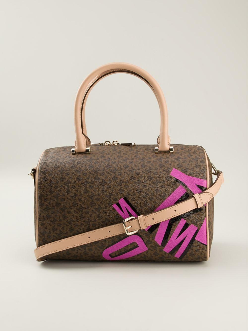 lyst dkny coated logo shoulder bag in brown