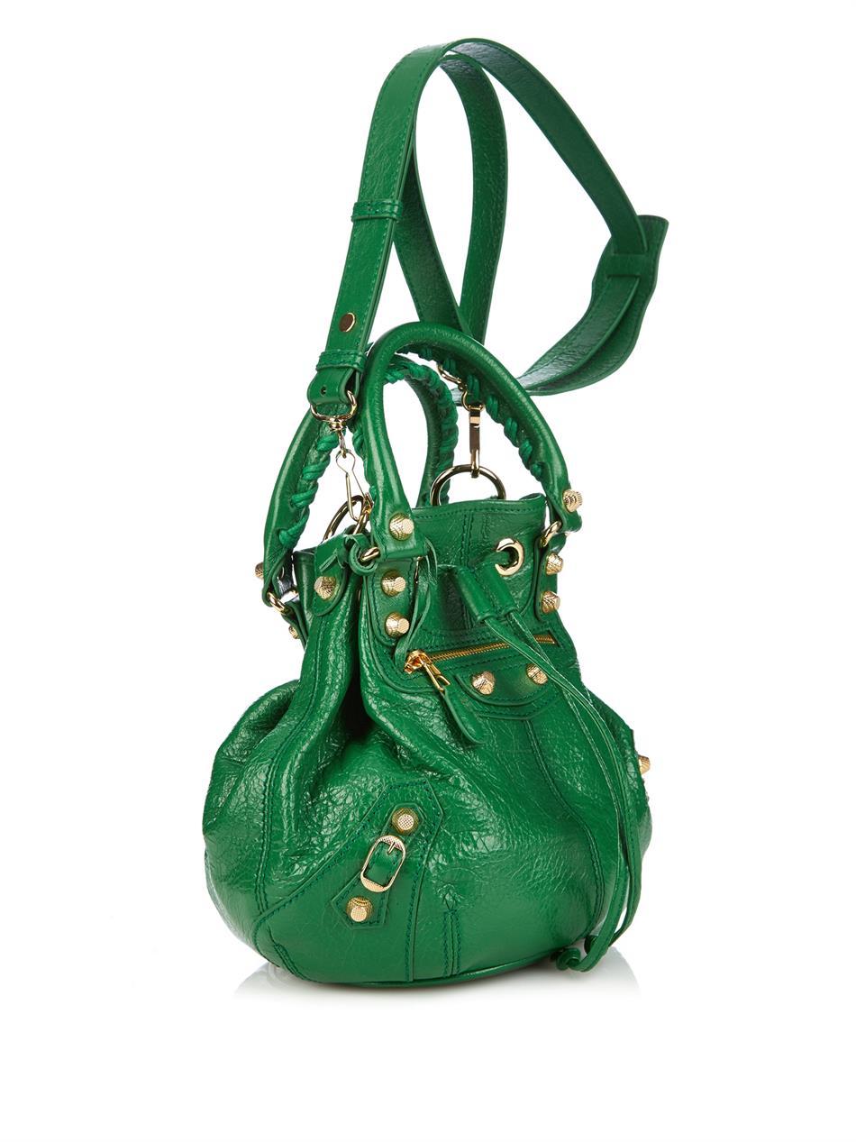 Lyst - Balenciaga Giant Pompom Leather Bucket Bag in Green 769631eff9f7b