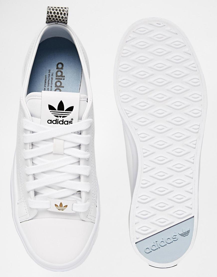 white adidas gazelle trainers