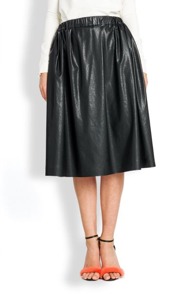 msgm faux leather midi skirt in black lyst