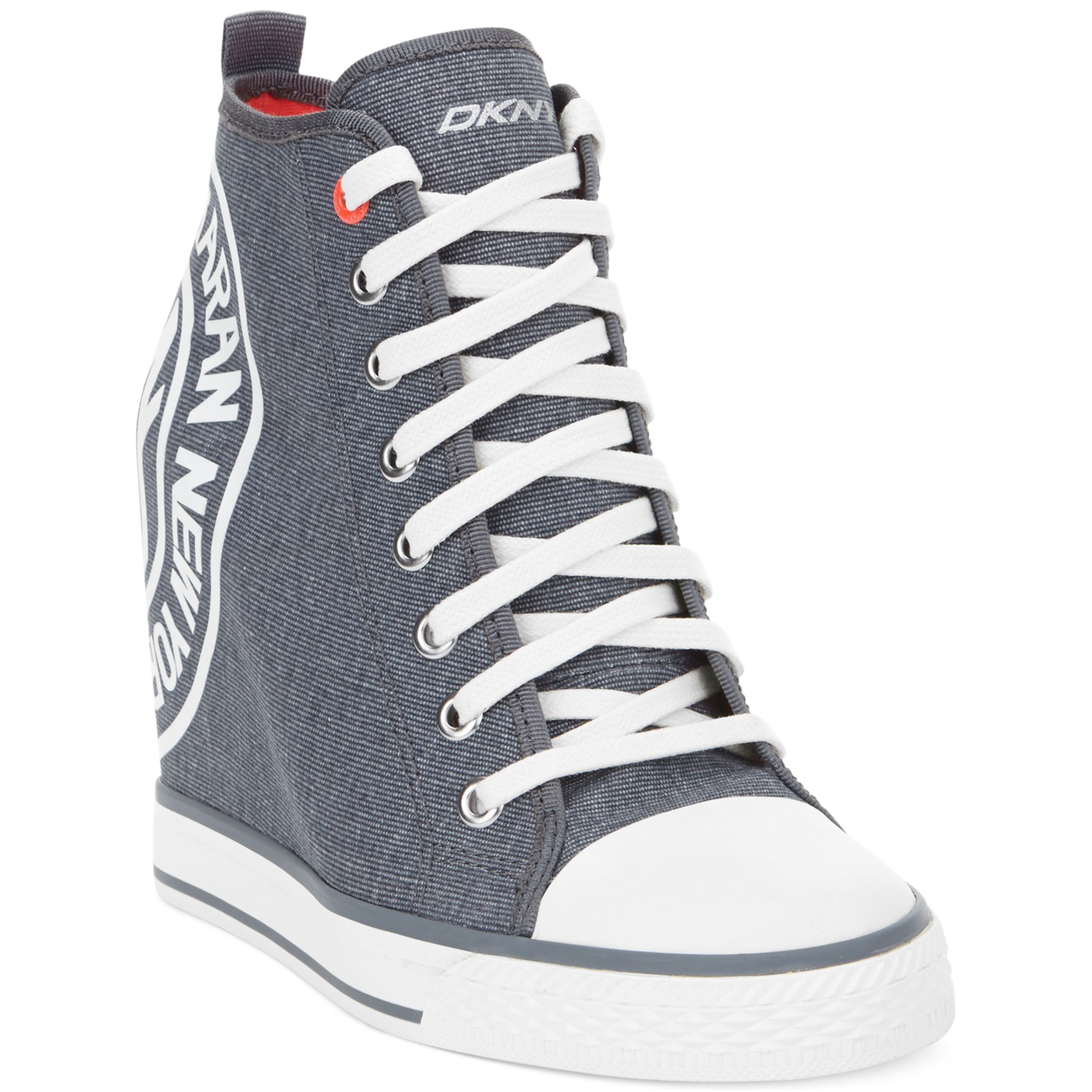 0c82258a9dc Lyst - DKNY Grommet Wedge Sneakers in Gray