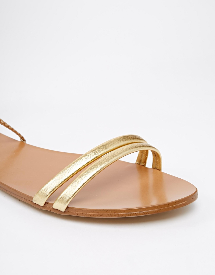 Lyst - ALDO Umarelle Gold Knee Gladiator Flat Tie Sandals in Metallic