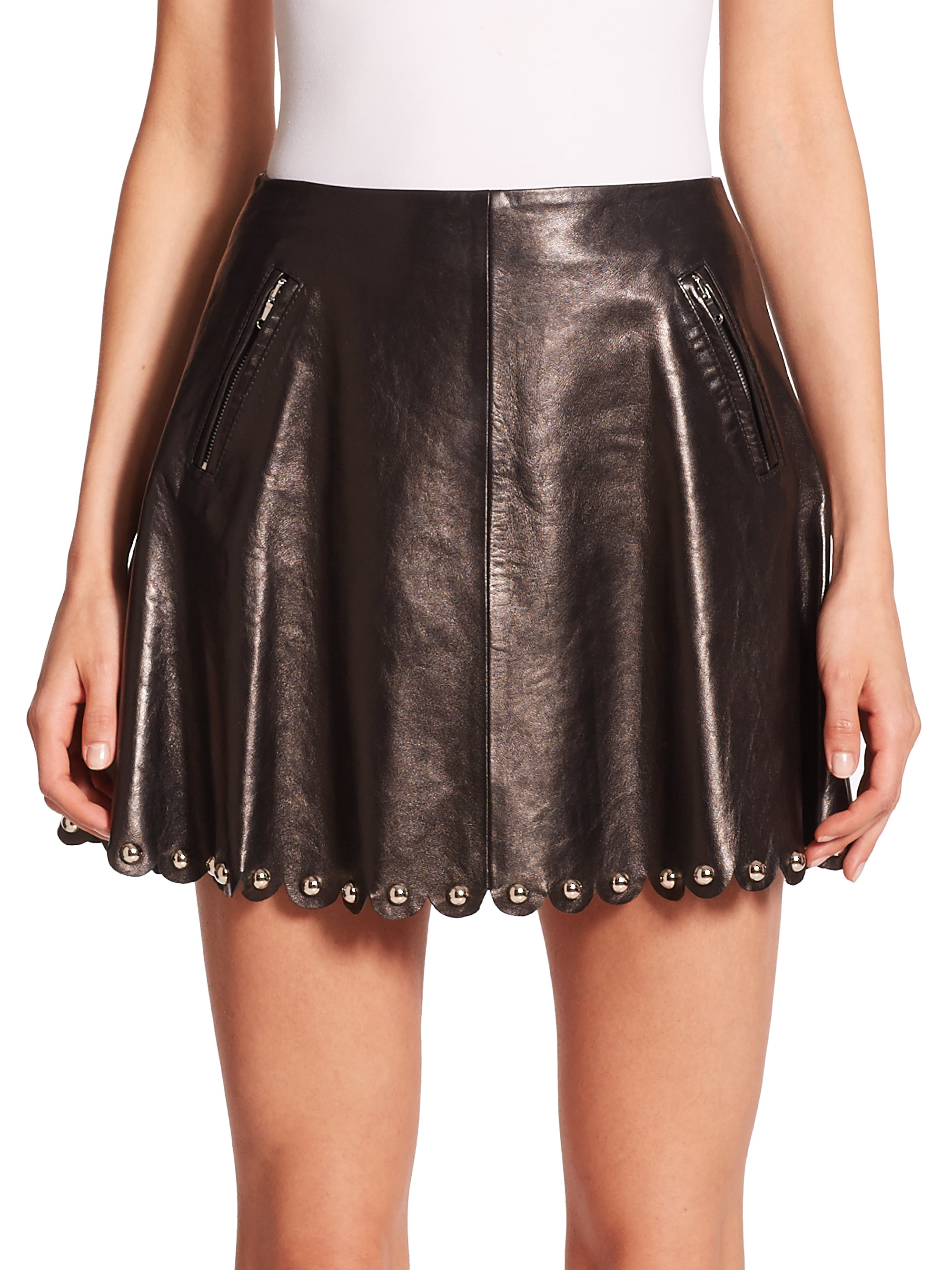 Light-pink leather mini skirt with yellow, purple and green leather stitching and silver-tone metal rounded studs. Versace skirt has a fitted waist, concealed zip fastening at side, triangular perforations at back and is fully lined in designer-printed pink satin. % leather; lining: rayon, 4% elastane. Dry clean.