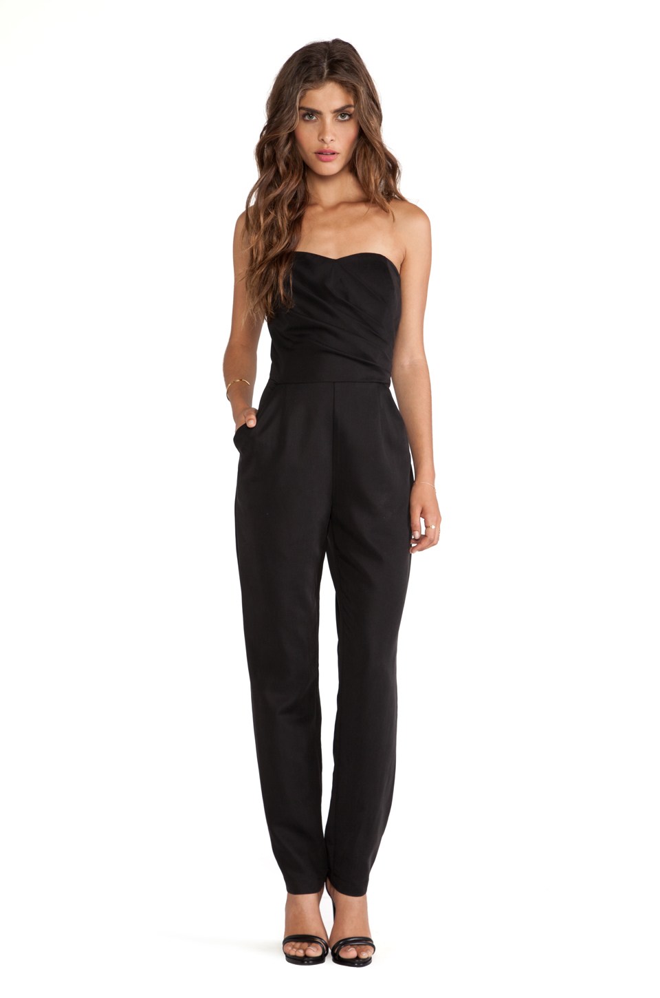 A strapless black romper finished in faux leather is effortlessly laidback and stunning. Exposed zippers and a sweetheart neckline give a touch of edge to this otherwise understated look. Coordinate with a cardigan or blazer for cooler nights or if you want a more formal appearance.