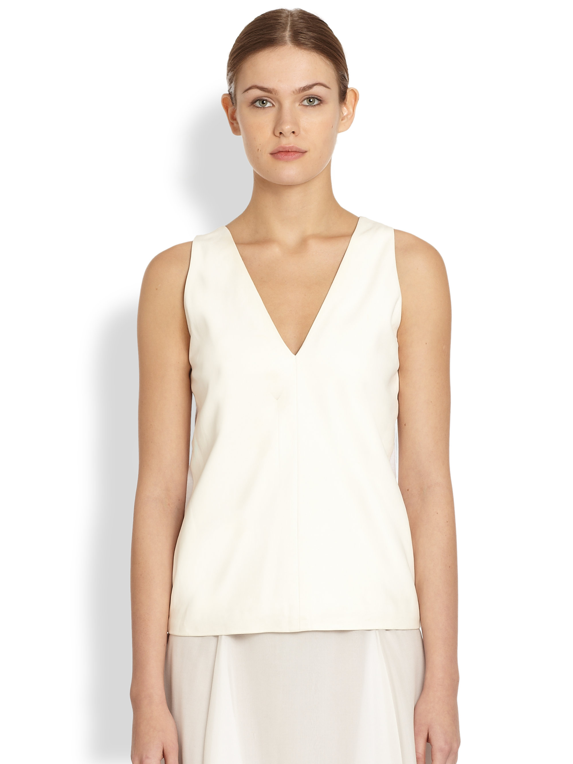 The cotton, polyester, and rayon-blend features a heart-shaped V-neck neckline and a left pocket. But don't worry about those irritating construction tags; this style is tag-free. Buy in bulk.