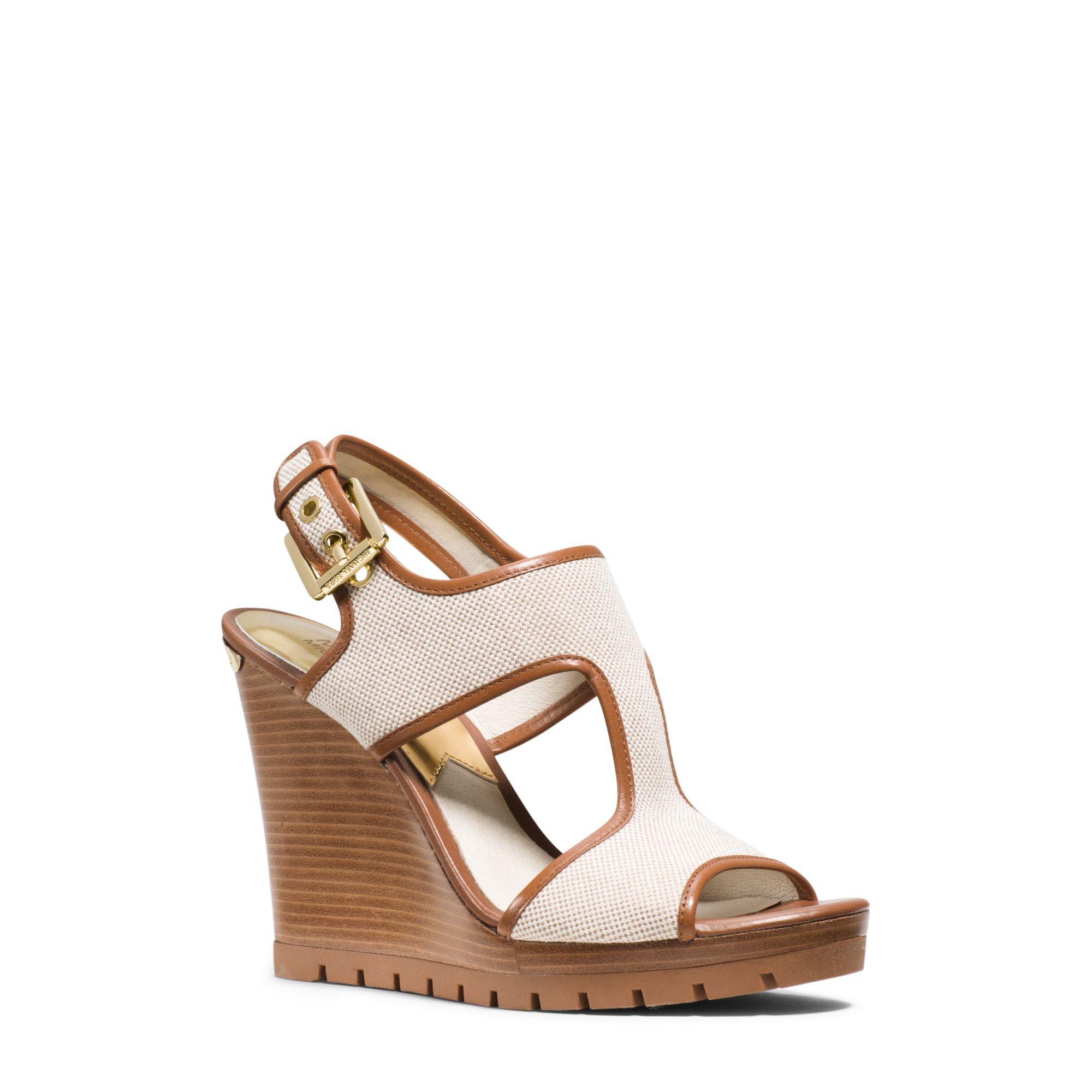 e0379ba5235e Lyst - Michael Kors Gillian Canvas And Leather Wedge in Natural