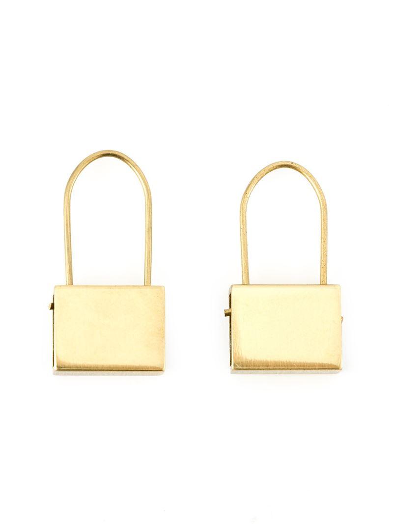 by air logo padlock earrings in metallic lyst