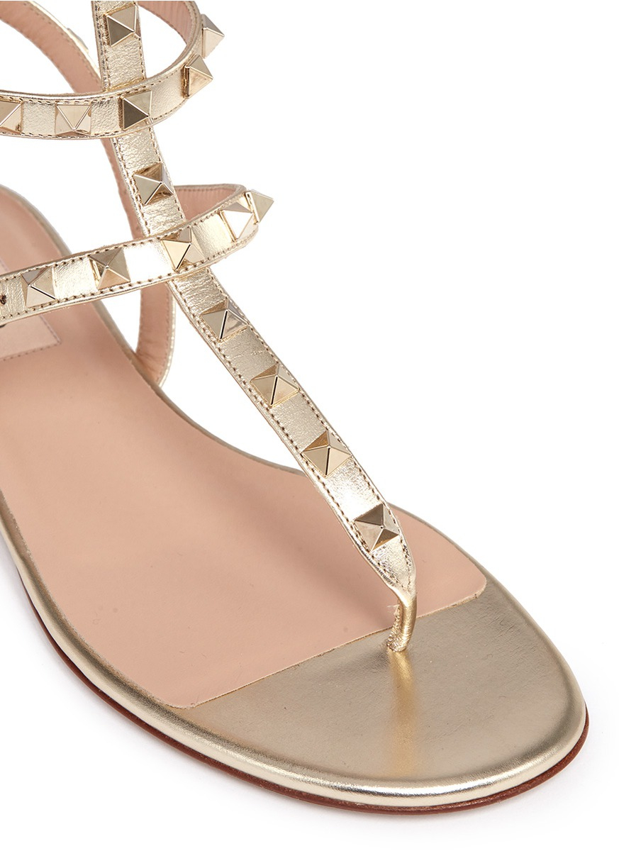 cf73b685631 Lyst - Valentino Rockstud Caged Metallic Leather Sandals in Metallic