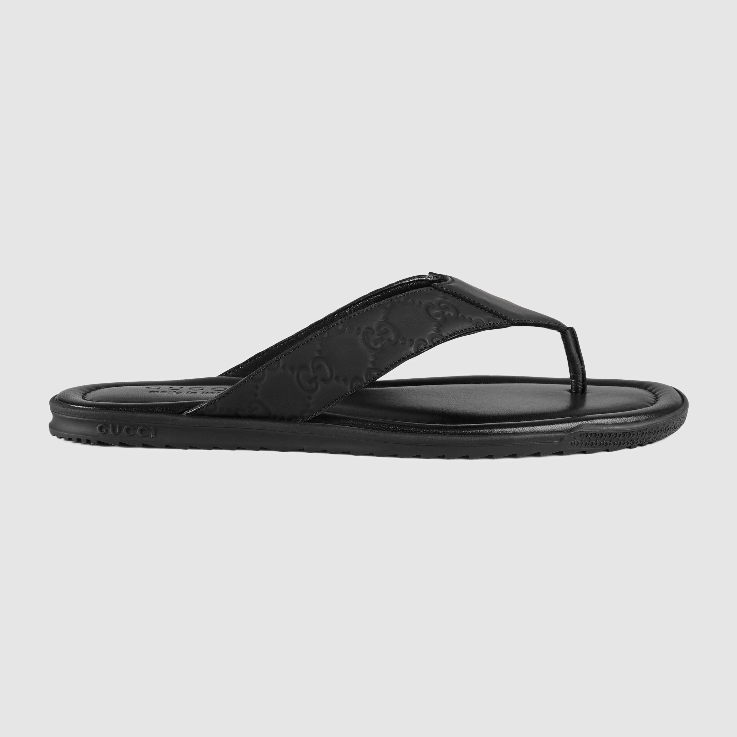 34f2810df Lyst - Gucci Rubberized Leather Thong Sandal in Black for Men