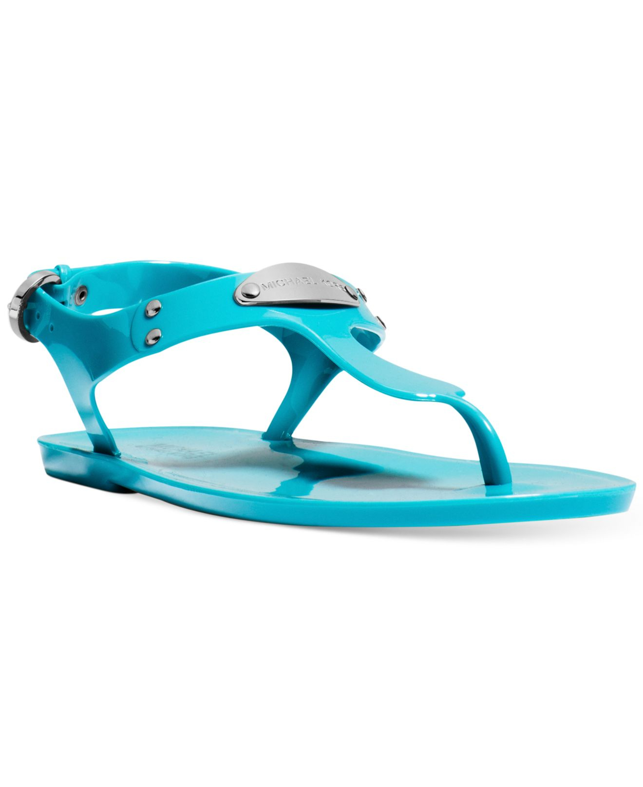 bb7a10b11838f Lyst - Michael Kors Michael Plate Jelly Sandals in Blue