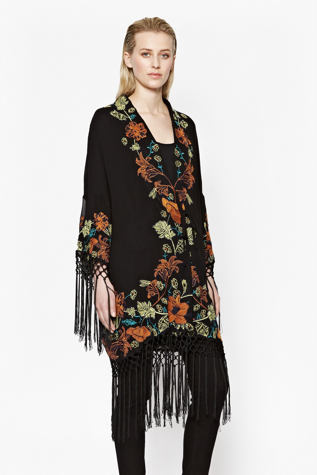 A vintage Asian-inspired print adds vibrant interest and silky texture to this black bouclé jacket. Styled with a deco button-and-loop closure, bracelet-length sleeves.