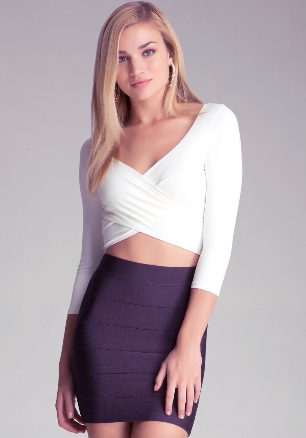 79fe5ccf2e2 Bebe 3/4 Sleeve Wrap Crop Top in White - Lyst