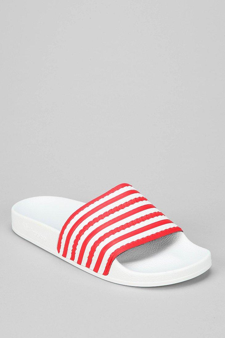 b5a2d1c19 ... cheapest lyst adidas adilette flag slideon sandal in white for men  ba113 8e601