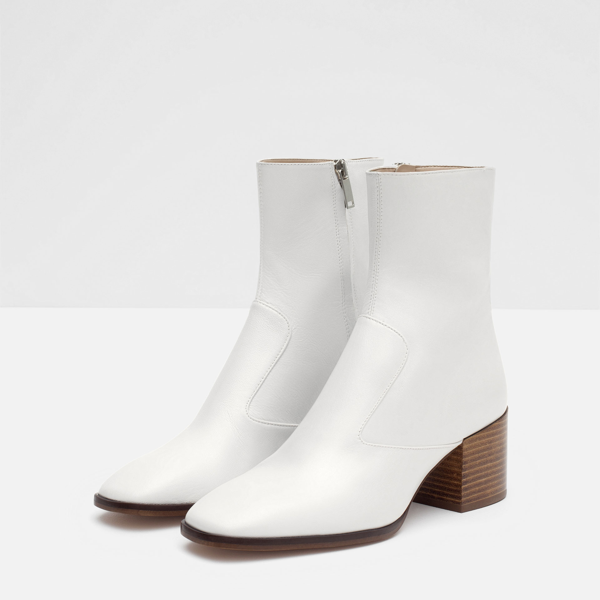 We've got great deals on white leather ankle boots from Giuseppe Zanotti.