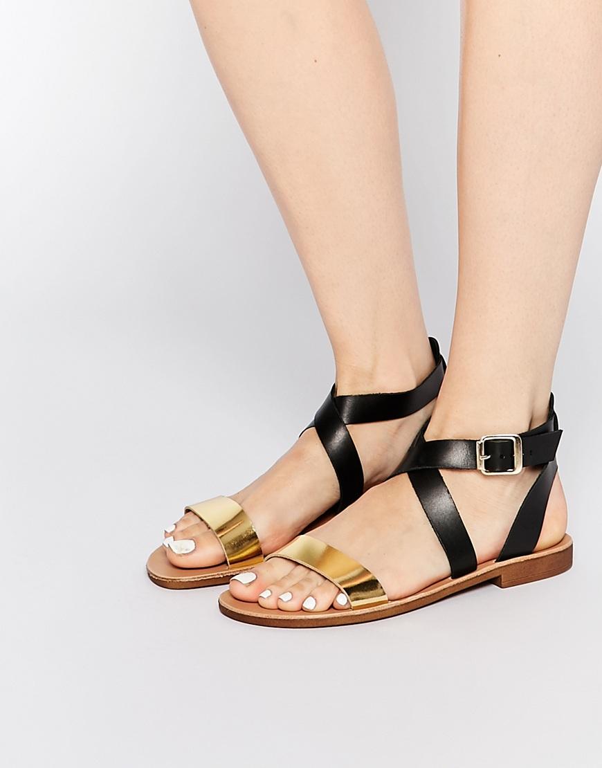 Lyst Dune Lottie Gold Amp Black Strap Flat Sandals In Metallic