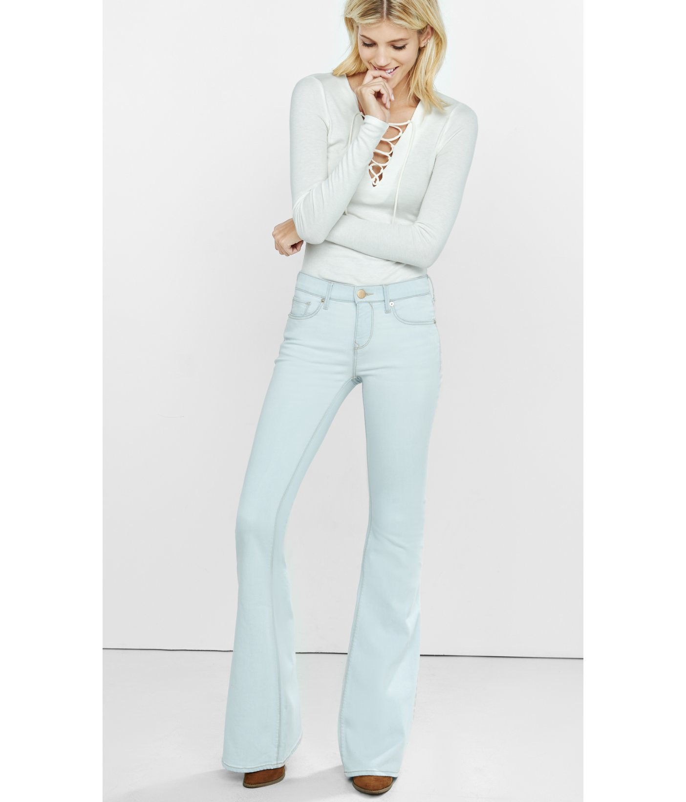 Lyst - Express Light Wash Mid Rise Bell Flare Jeans in Blue