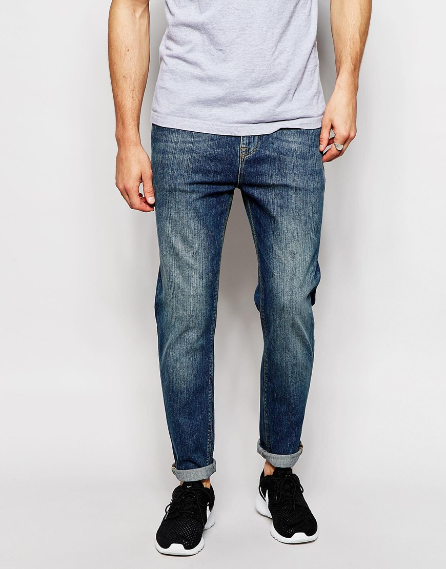 asos tapered jeans in vintage dark wash mid blue in blue for men lyst. Black Bedroom Furniture Sets. Home Design Ideas