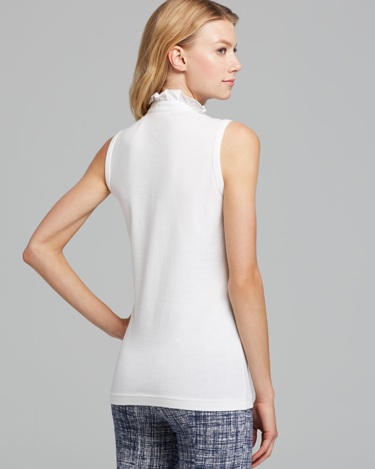 d748bd0bfe5 Lyst - Tory Burch Sleeveless Lidia Polo Shirt in White