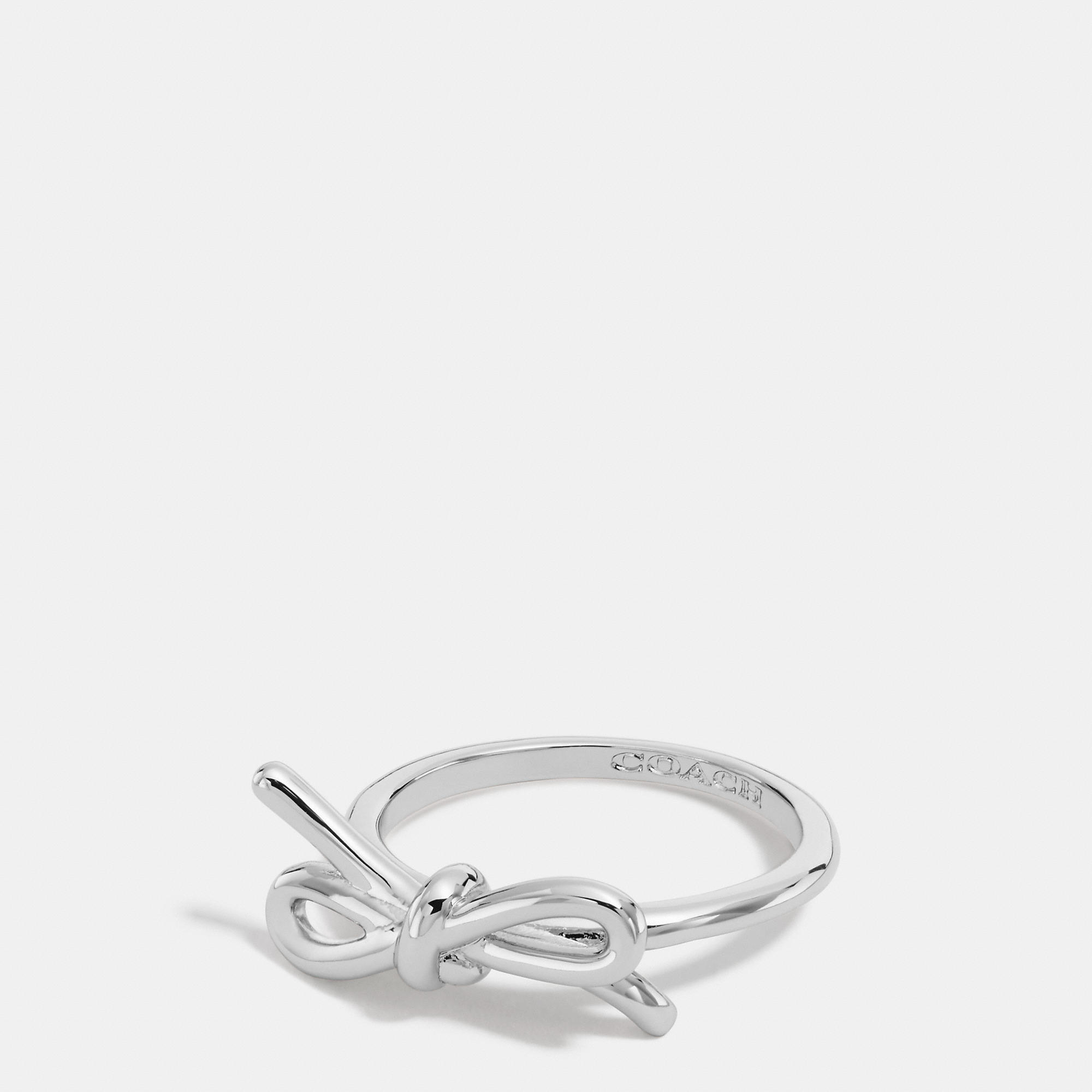 Coach Sterling Bow Ring in Metallic