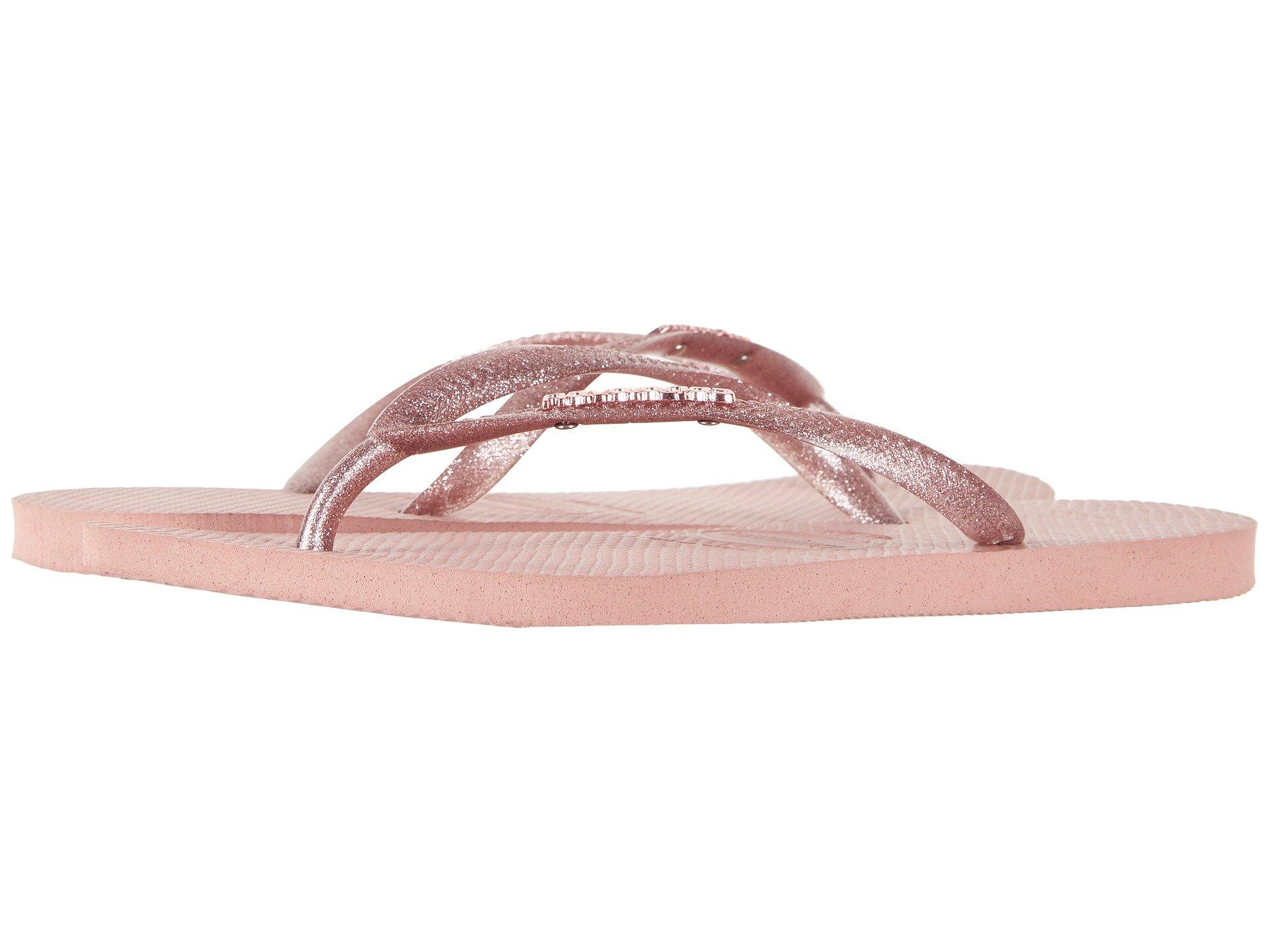 5cb502315 Lyst - Havaianas Slim Logo Metallic Flip Flops in Pink - Save 53%