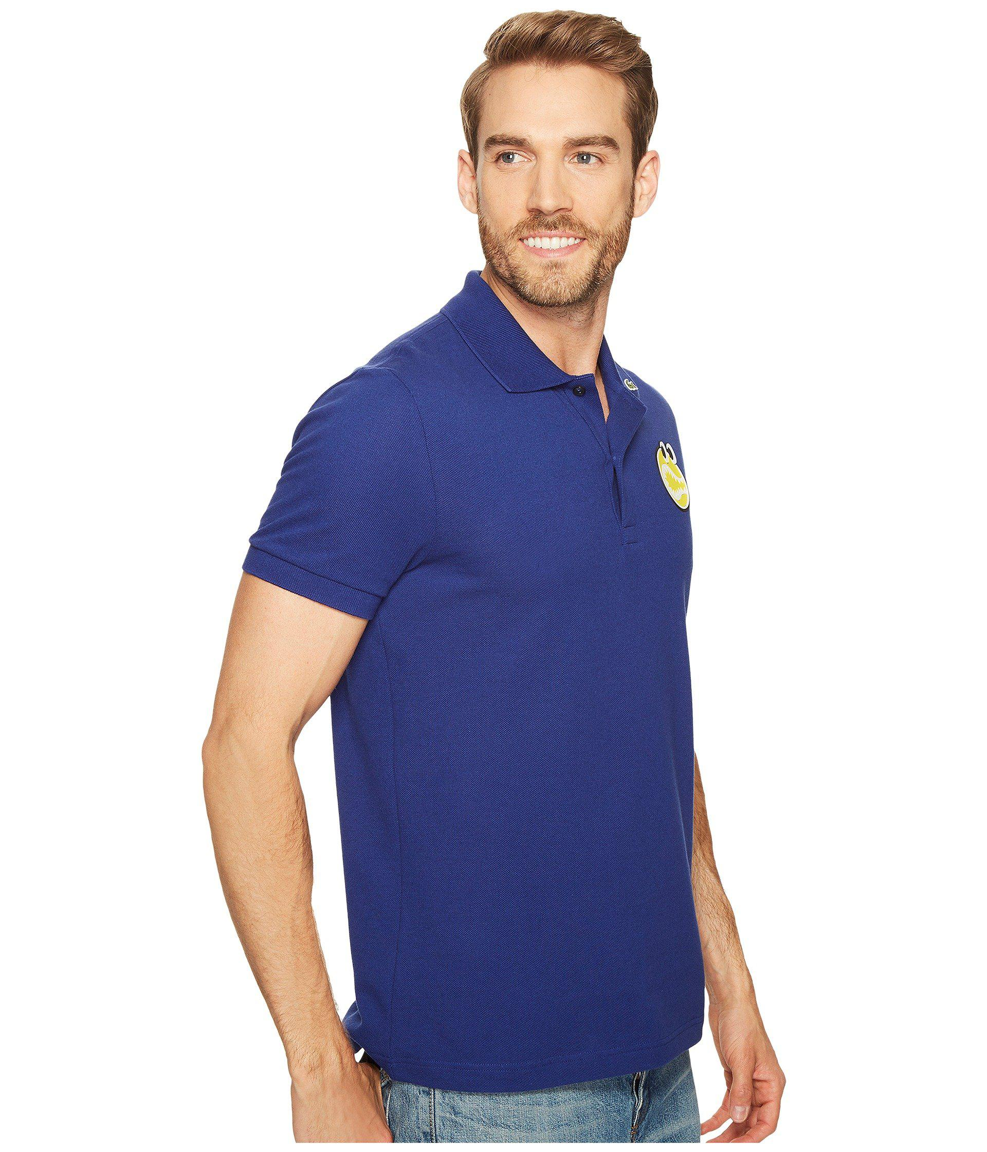 11e31a9d Lacoste Yazbukey Short Sleeve Pique With Googly Eyes Graphic in Blue ...
