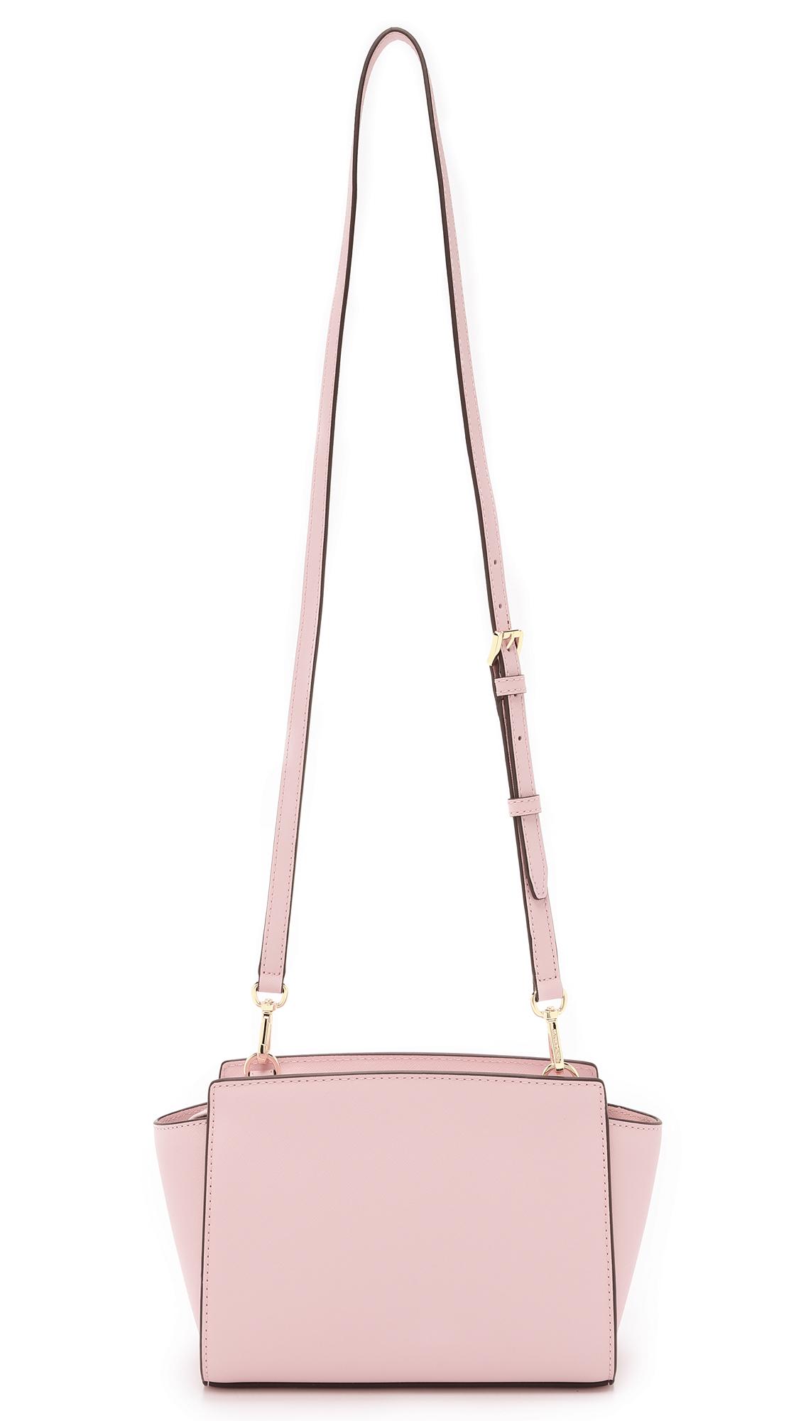 3856b6366ff6c ... where to buy lyst michael michael kors selma medium messenger bag optic  white in pink 71387