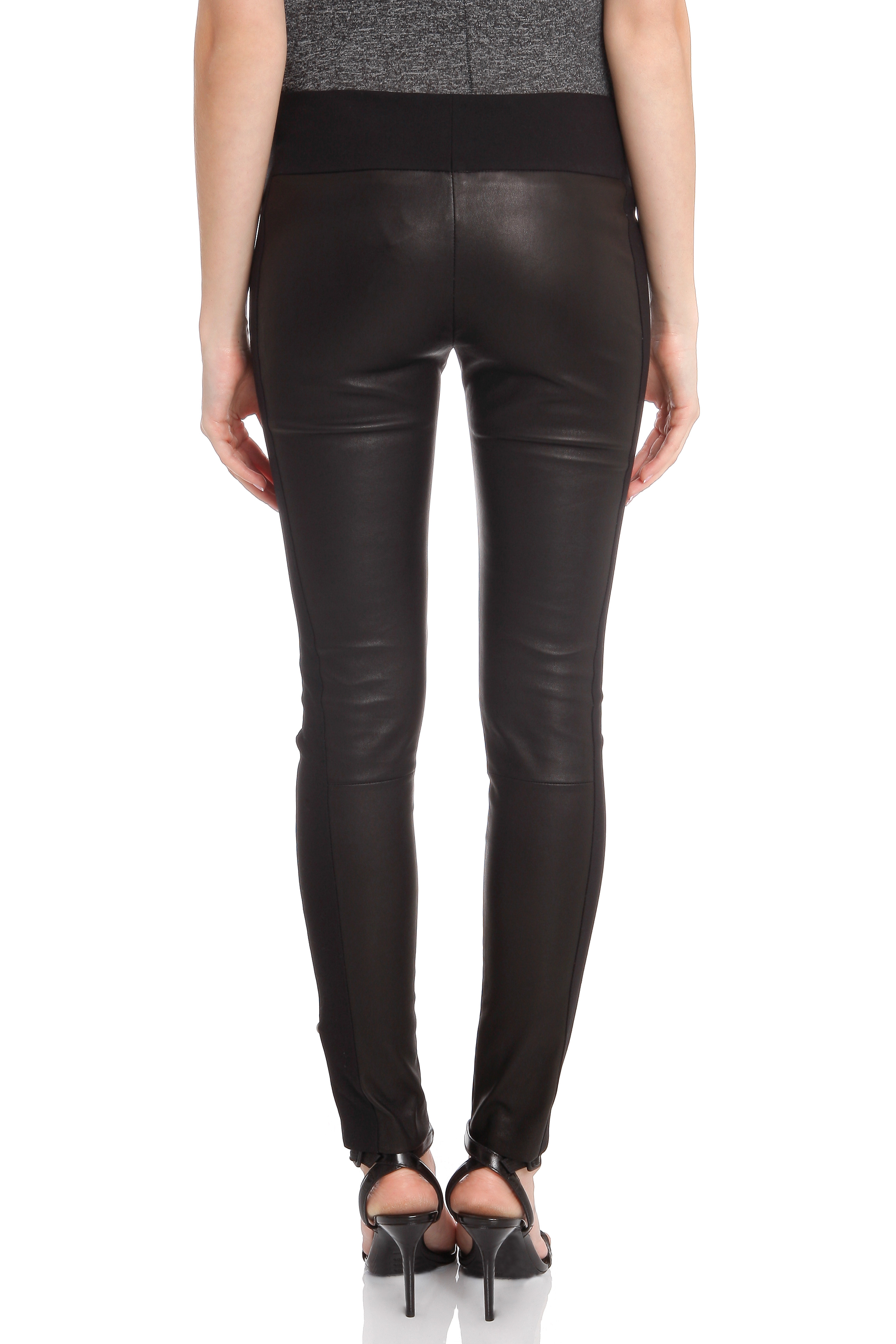 "High waisted black and vegan ""leather"" panel leggings. Flattering faux leather,black panel, runs the length of a the pants out side thigh. This trendy feature makes these great for going out, comforta."