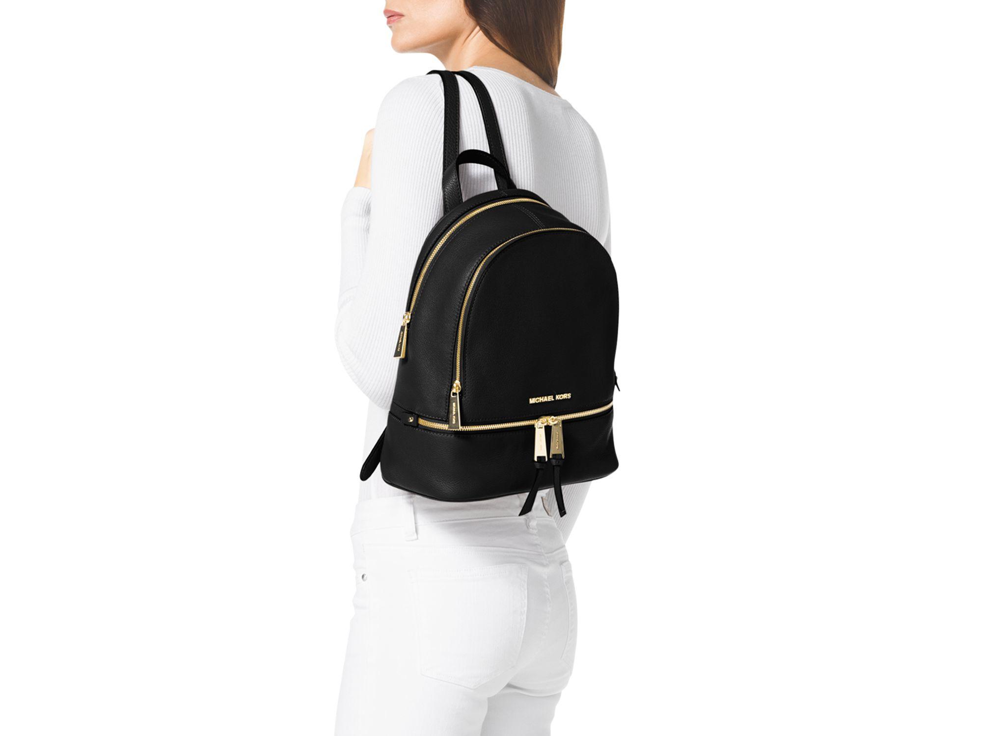 d3ce1f1940e4 ... sweden michael michael kors small rhea zip backpack in black lyst d0719  f4c08