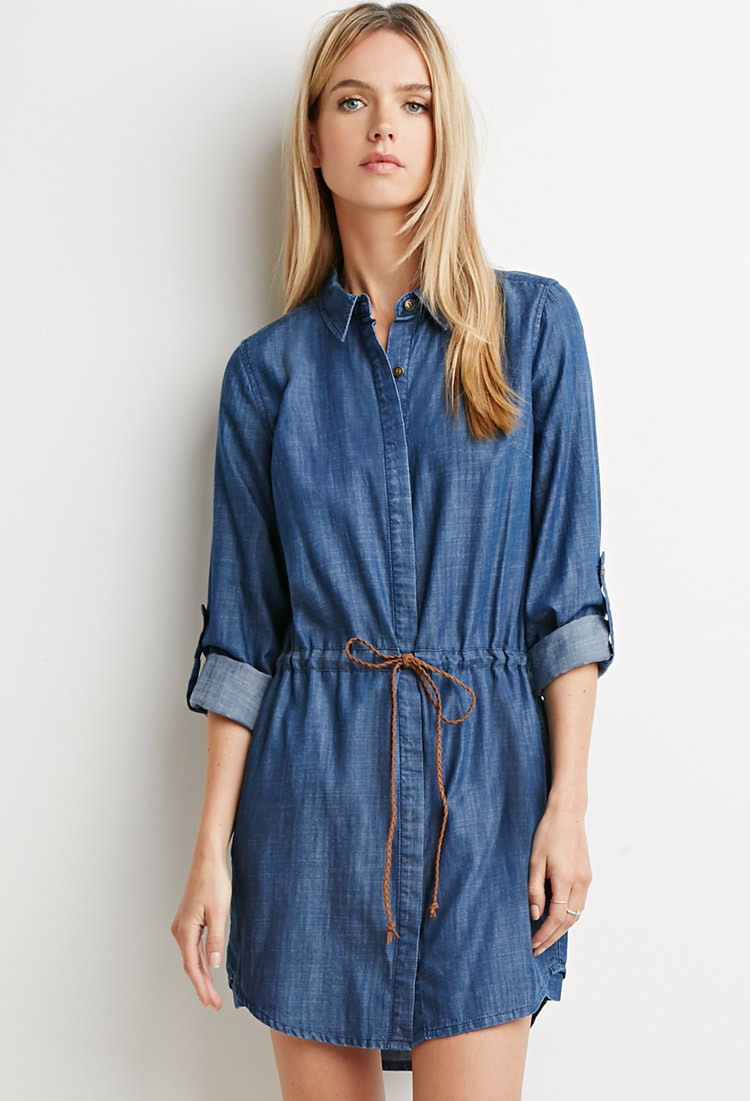 Size guide Fit & Sizing Straight from top to bottom for an easy, relaxed fit. Shirt dress hits approximately mid-thigh. Model is 5'9