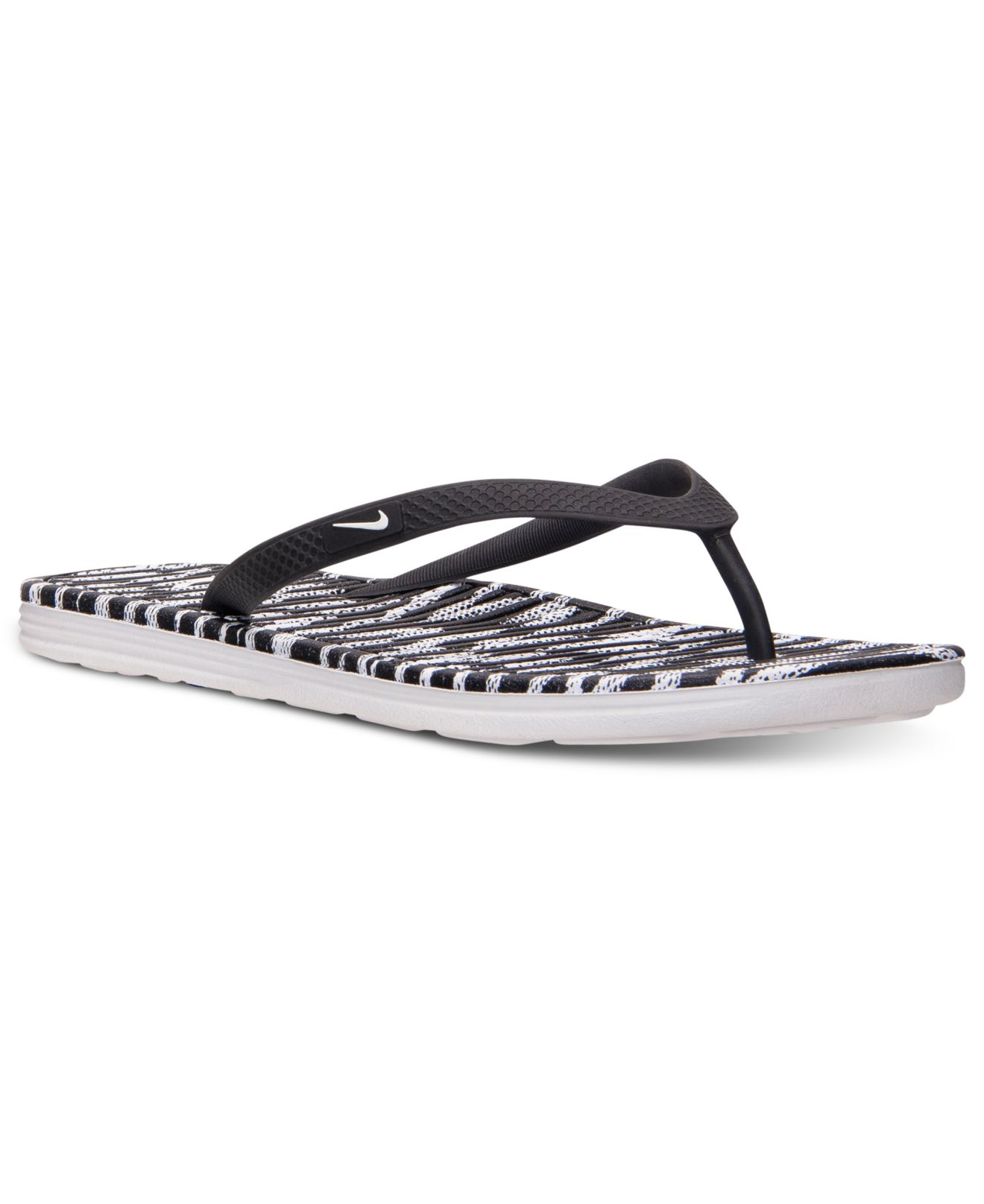01431b244 Lyst - Nike Women s Solarsoft Thong Ii Sandals From Finish Line in White