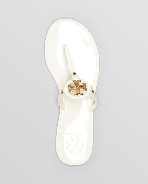 19d73f4864 Tory Burch Mini Miller Jelly Flat Thong Sandals in Black - Lyst