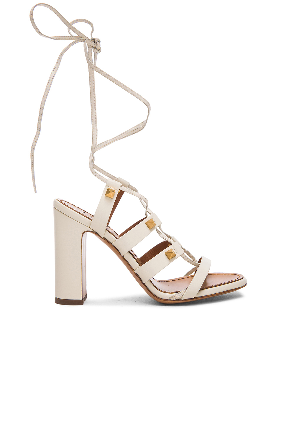4828cc2b2c4 Lyst - Valentino Rockstud Leather Gladiator Heels T.100 in White