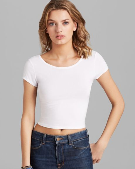As you can see from the photo, Olivia is wearing a fairly simple cashmere sweater top. According to her website, she tucked the sweater into a pair of chic white shorts that hid under a full tulle skirt overlay.