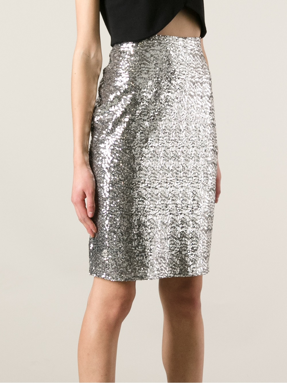 This ultra Fabulous skirt features holographic silver sequins all over, flirty skater silhouette and a zipper on the back it's full lined. This lovely piece can be dress up with a sheer blouse or a matching sequin top or dress down with basic sweater. % polyester model wearing size small and she is 5'7 Dry clean only Made in USA Made to order.