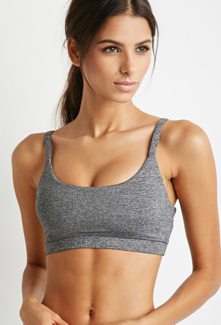 c845c943d5 Lyst - Forever 21 Medium Impact - Caged-back Heathered Sports Bra in ...