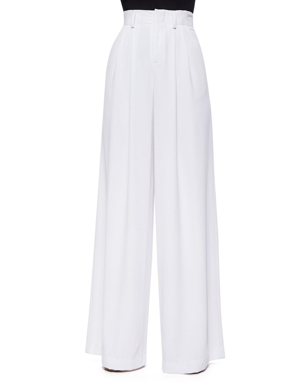 More Details THE ROW Lian High-Waist Wide-Leg Wool Pants Details The Row