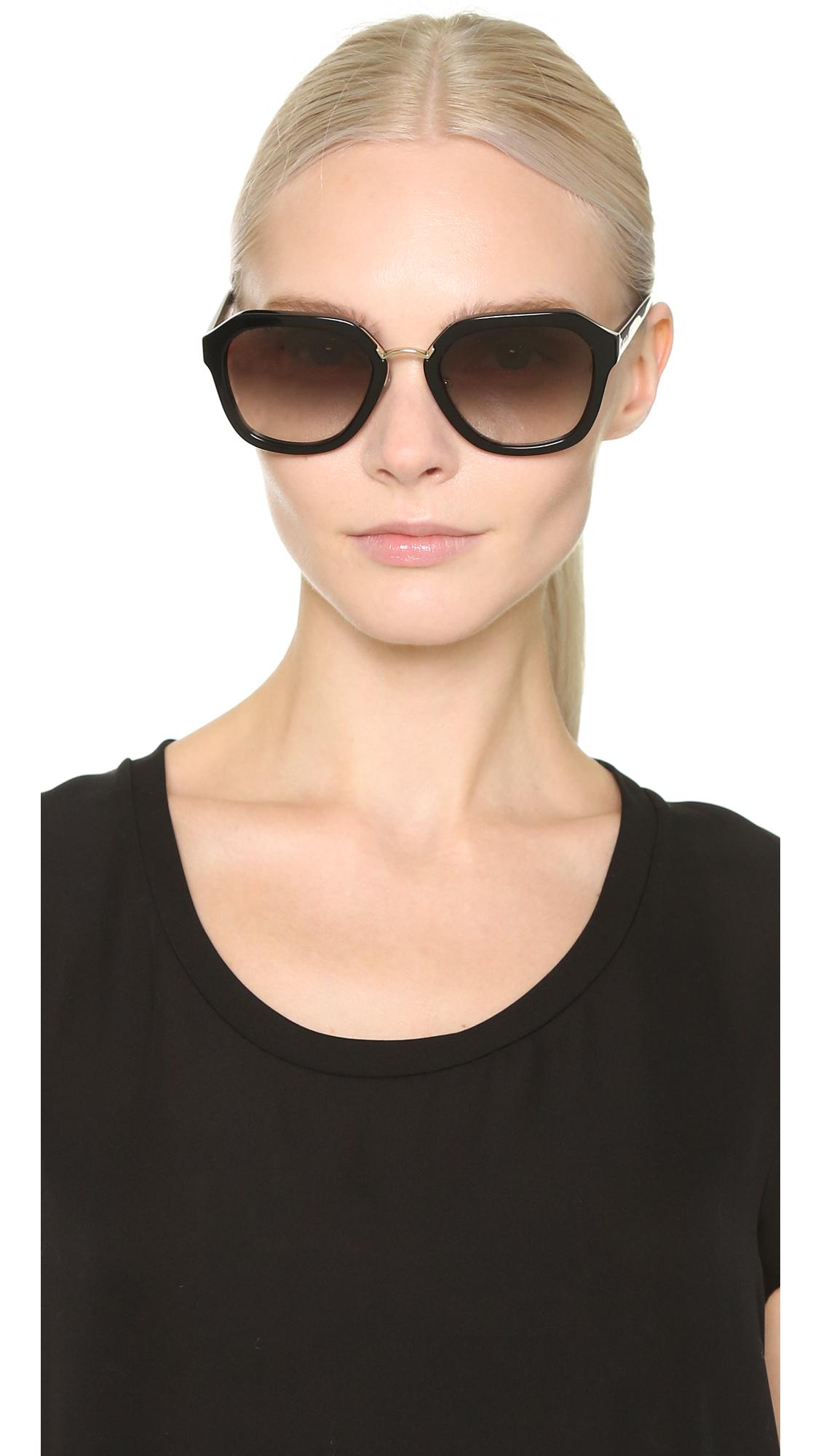 55291ee3b7 order lyst prada metal bridge sunglasses black grey gradient in black 34c5f  41a88