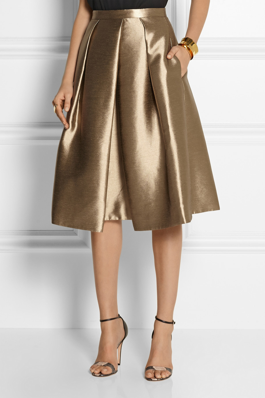 We feature gold skirts made in many different types of fabric, from gold lamé, to gold chiffon. Our gold skirts come in a wide variety of styles and are sized to fit all body types. Our gold shirts come in mini, midi and maxi lengths, providing you with many choices, and a good deal of variety.