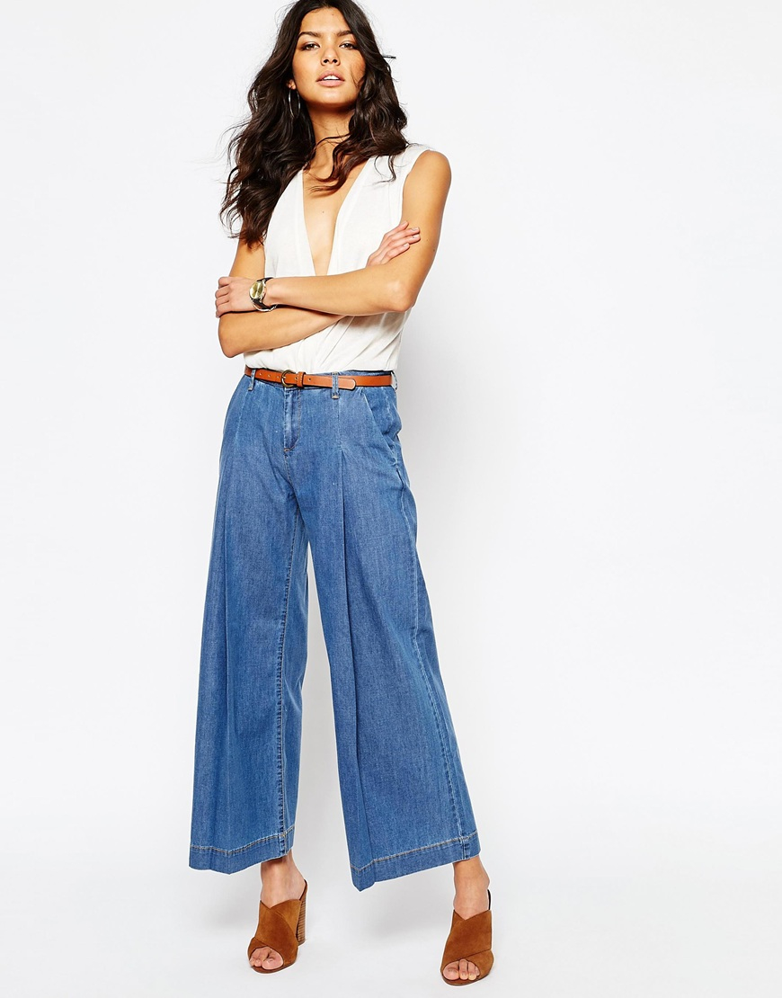 Wide Leg Trouser Jeans: Quality jeans feature lots of high-end details, including a wide waistband with three buttons and trapunto stitching all around. The high waist smooths your tummy and the full legs balance your figure. Side slash pockets.