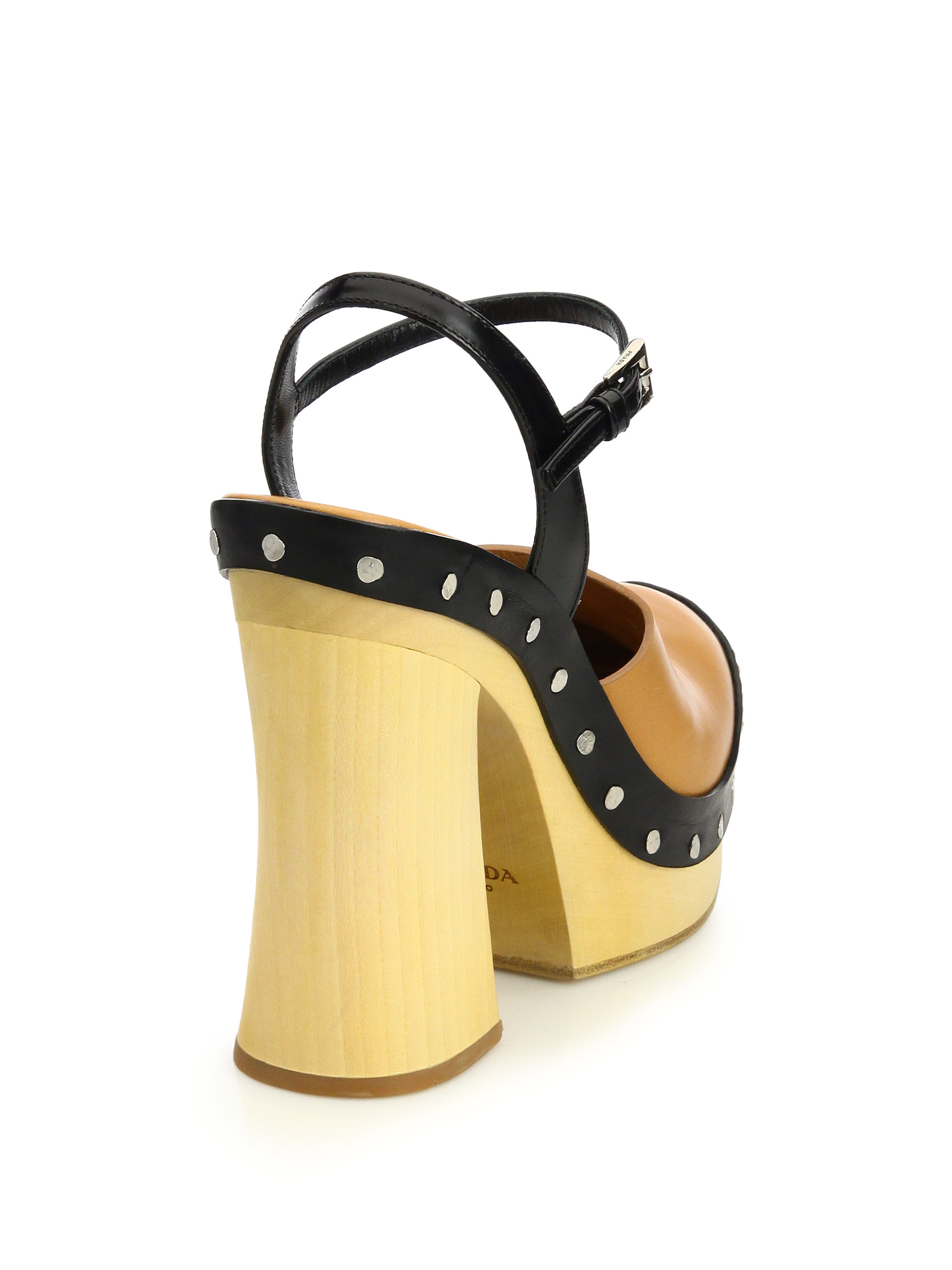 5e3b861b65a Lyst - Prada Wooden-Heeled Leather Platform Sandals in Brown