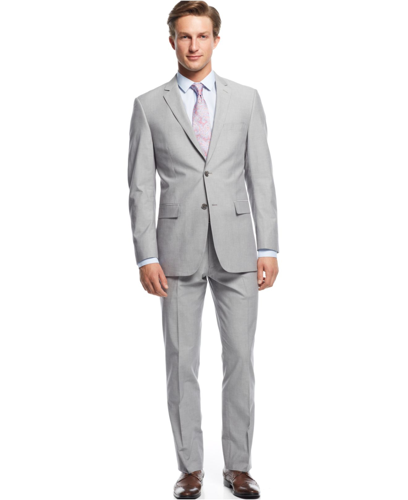 Light grey suits are incredibly popular right now, especially for weddings. This grey slim fit suit is particularly in demand with it's ultra-soft polyblend fabric, slim notch lapel, and tapered sleeves that complete the slim fit look.