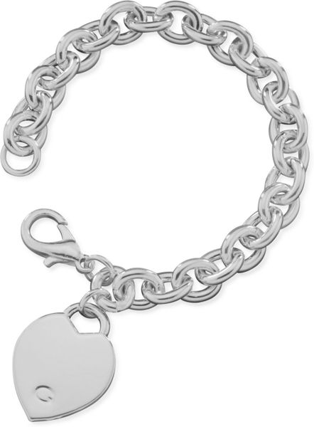 guess bracelet polished silver tone heart in silver lyst. Black Bedroom Furniture Sets. Home Design Ideas