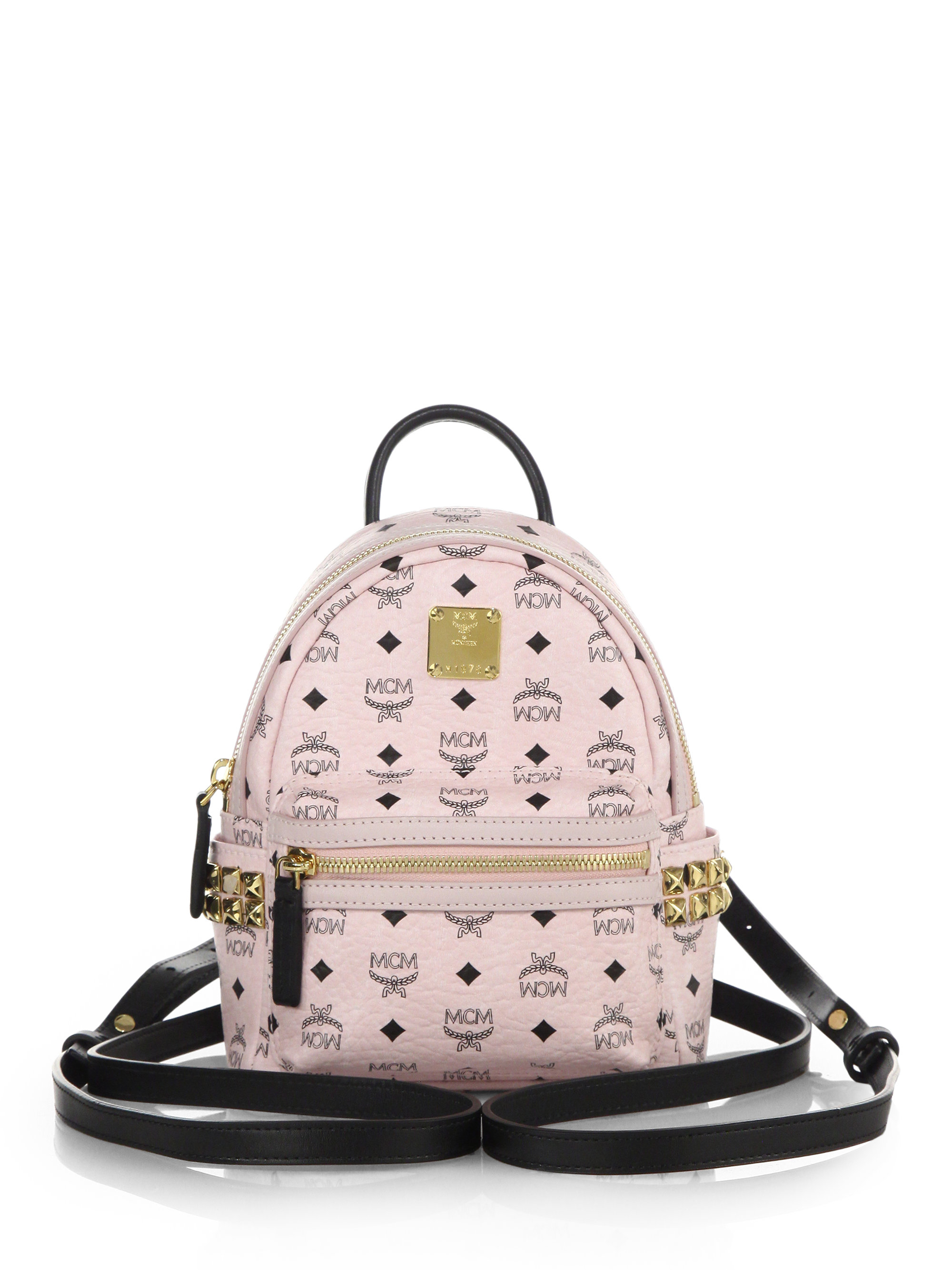 Lyst - MCM Stark Side Stud X Mini Coated Canvas Backpack in White a81e4284a89ee