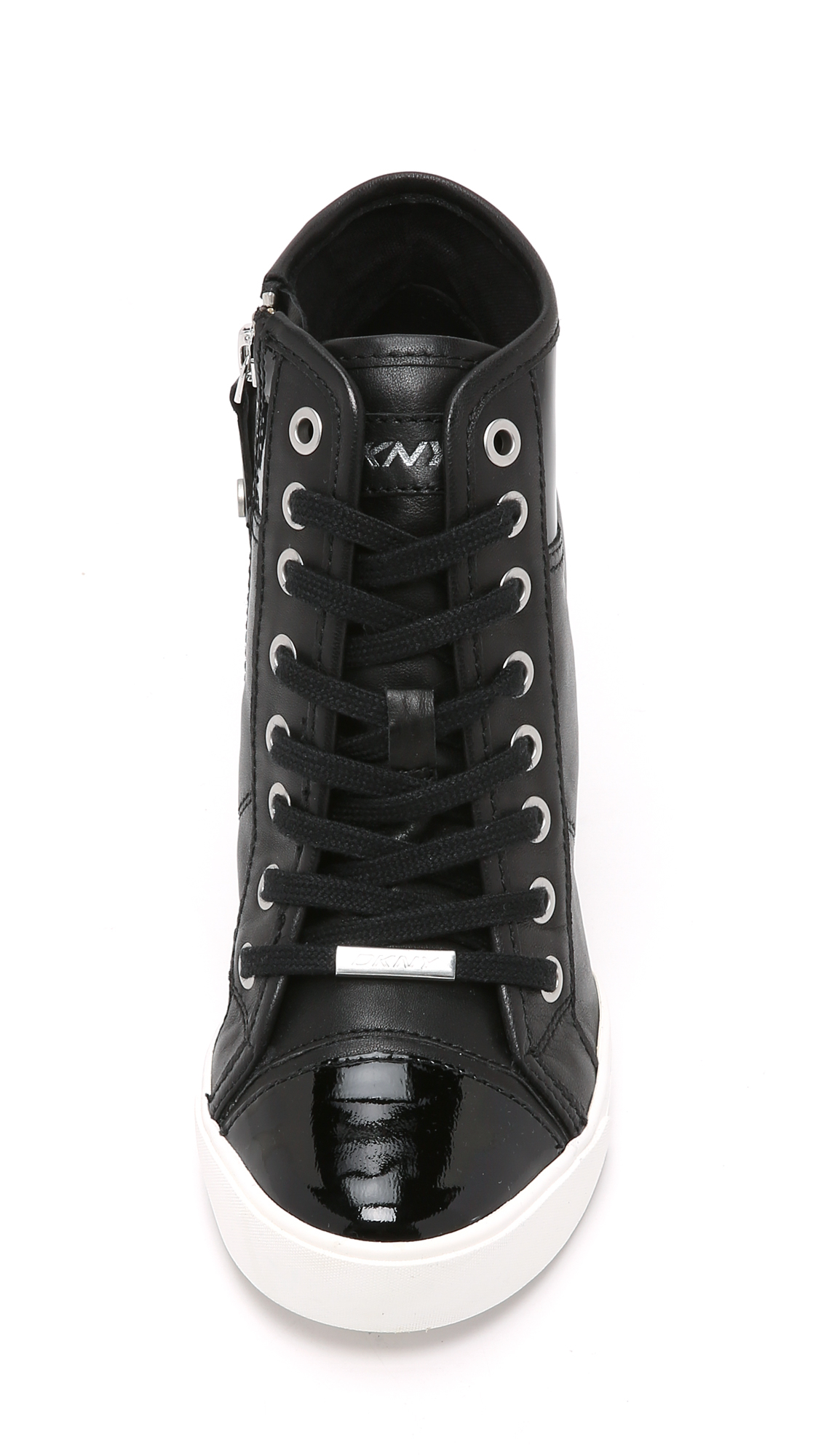 e40ea436d19 Lyst - DKNY Grommet Zip Wedge Sneakers in Black