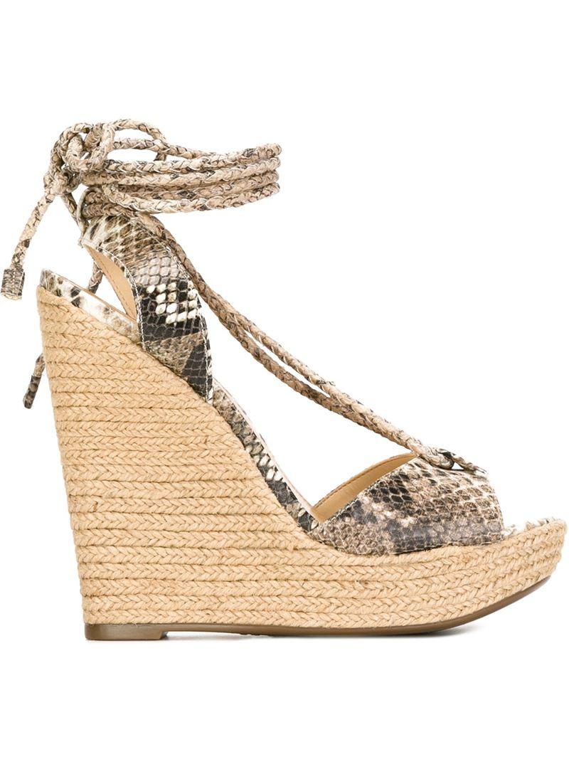 schutz snakeskin print wedge sandals in brown lyst