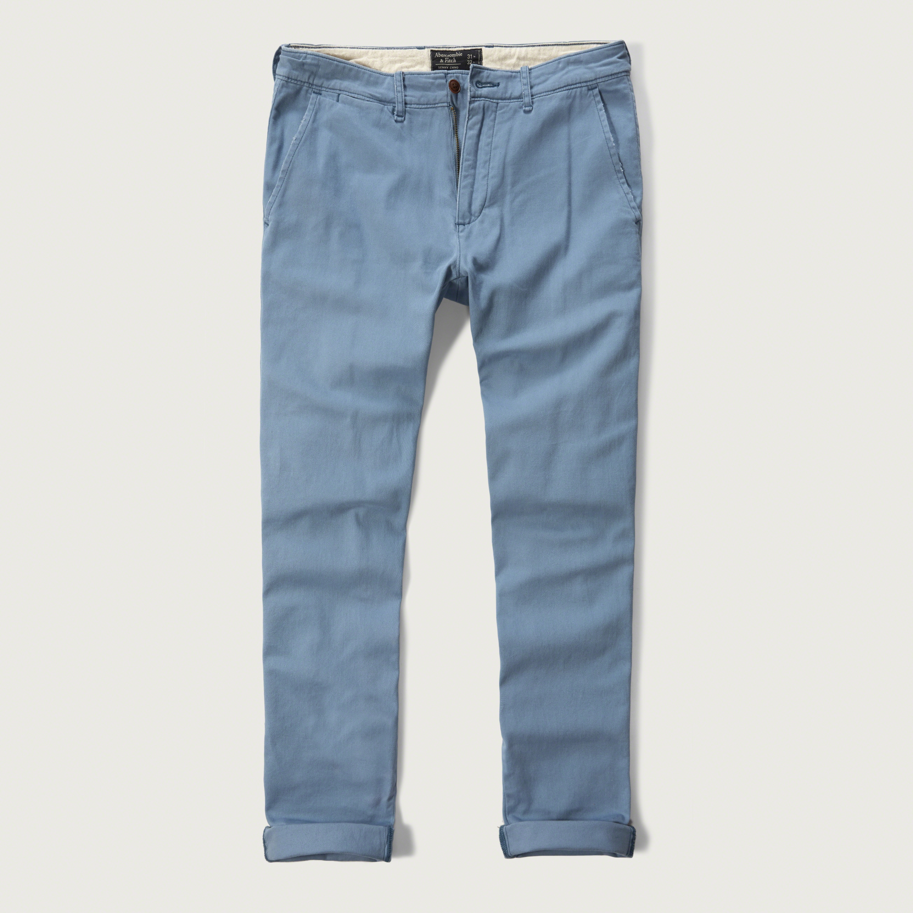 Men. New Arrivals +Plus Coming Soon Gambino Chino Pants - Blue. SHARE. $USD. PRODUCT DETAILS. Available in Black, Olive, Khaki, And Blue; Zip Fly With Button Closure; Slant Pockets; Back Welt Button Pocket; 98% Cotton 2% Spandex; SHIPPING INFORMATION.