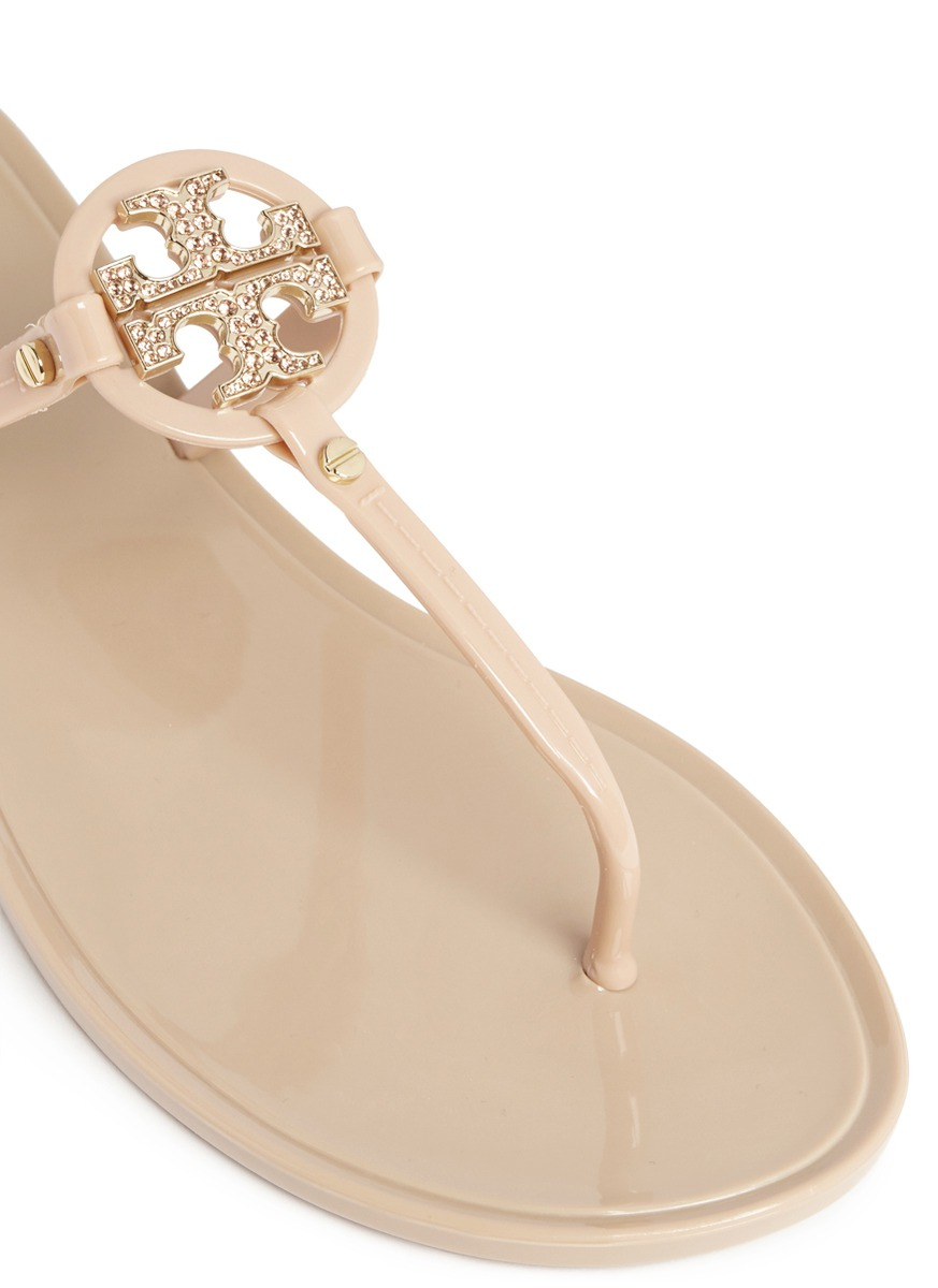 0d2126f73900 Lyst - Tory Burch  Mini Miller  Crystal Logo Jelly Thong Sandals in ...