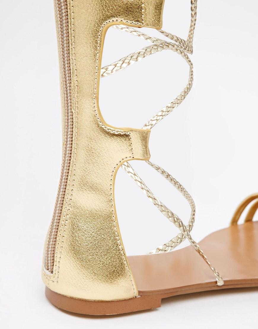 9d9d7e132a0 Lyst - ALDO Umarelle Gold Knee Gladiator Flat Tie Sandals in Metallic