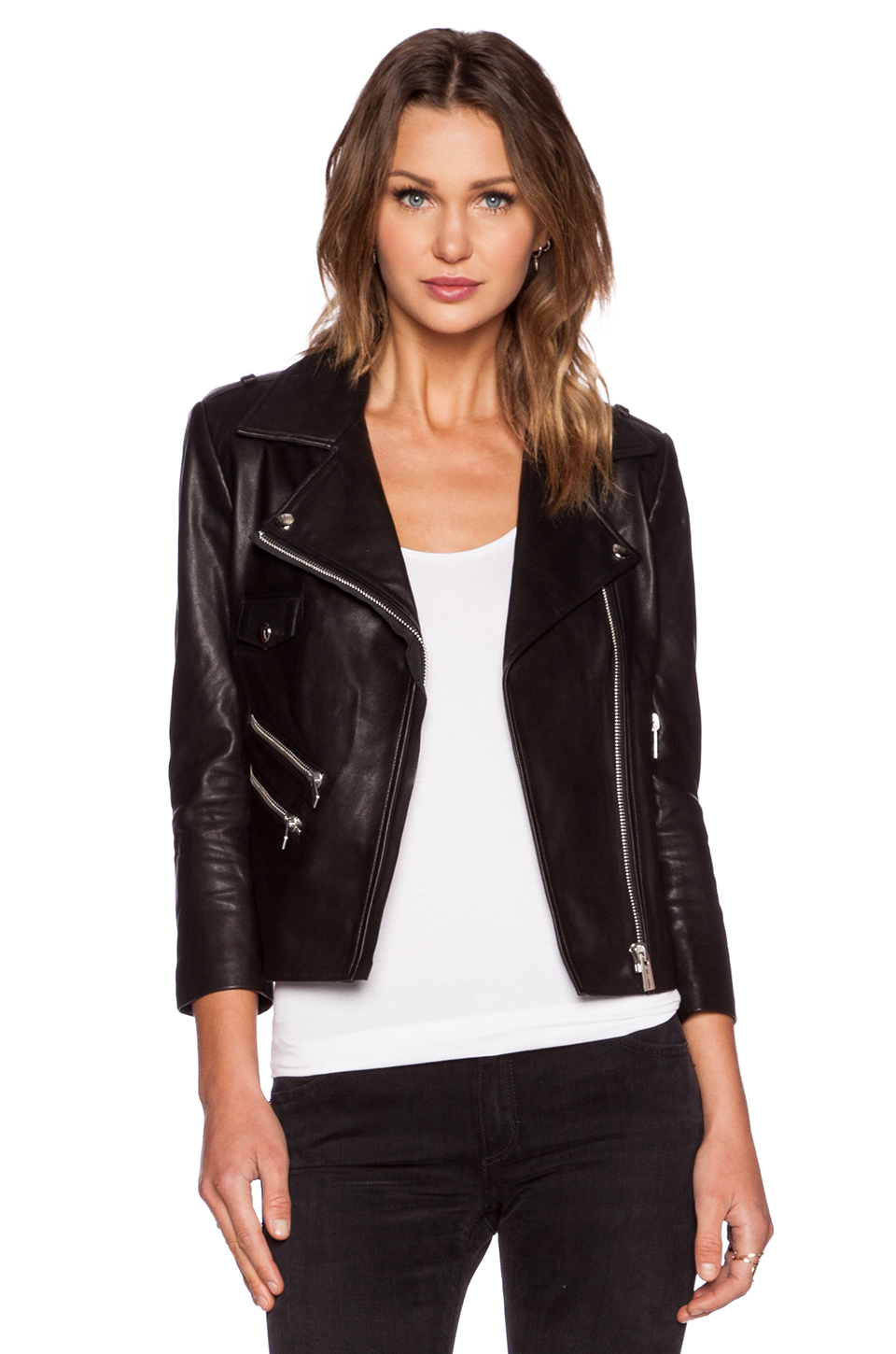 Cut from % calf leather, the cropped moto jacket is sculpted to exude an elevated garment with rebellious edge. Pebbled leather, silver hardware and a removable belt .