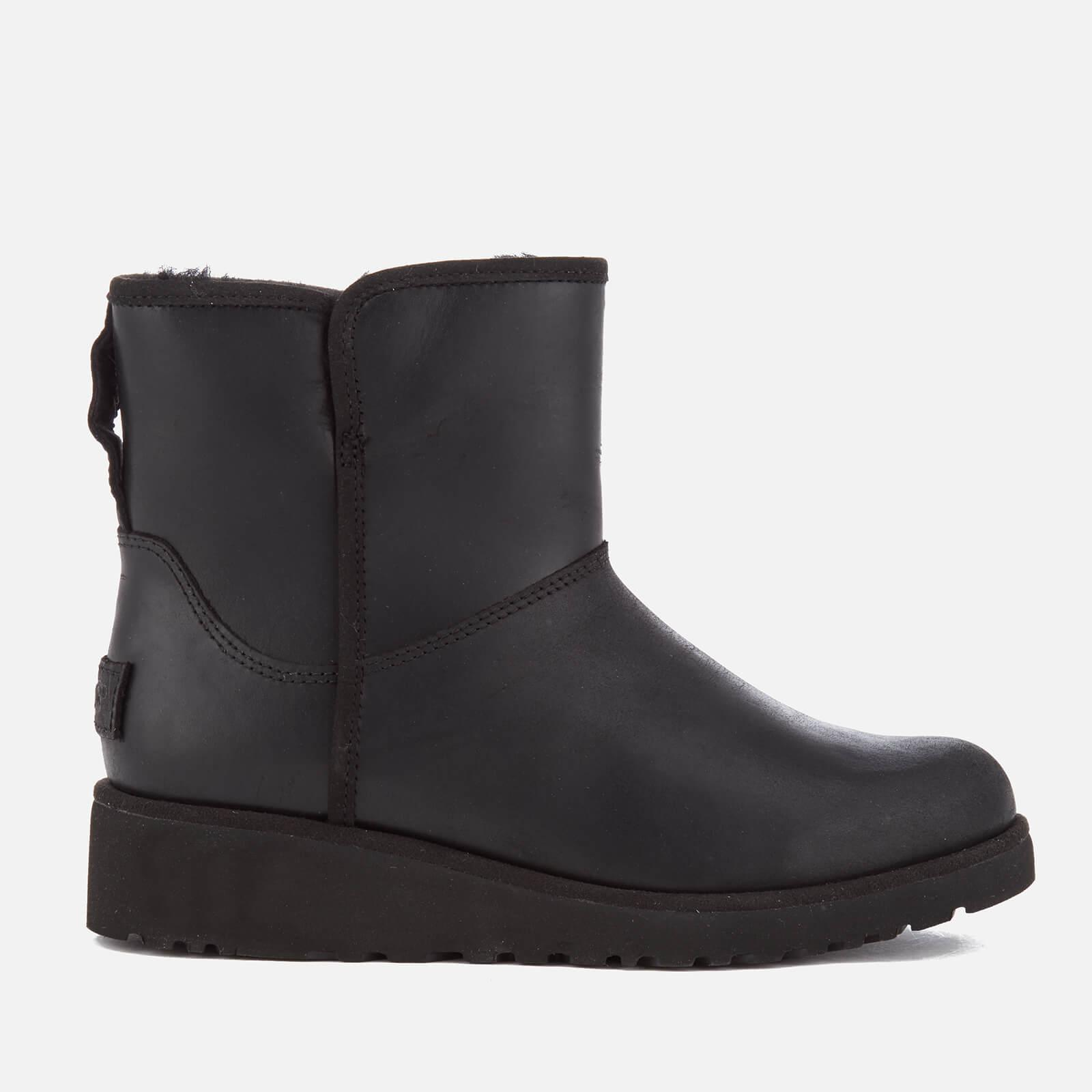 06690dca4c9b UGG Women s Kristin Classic Slim Leather Sheepskin Boots in Black - Lyst